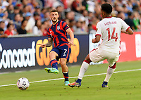 AUSTIN, TX - JULY 29: Paul Arriola #7 of the United States passes the ball to a teammate during a game between Qatar and USMNT at Q2 Stadium on July 29, 2021 in Austin, Texas.