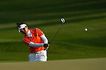 CHON BURI, THAILAND - FEBRUARY 17:  Pavarisa Yoktuan of Thailand plays her aproach shot on the 18th hole during day one of the LPGA Thailand at Siam Country Club on February 17, 2011 in Chon Buri, Thailand. Photo by Victor Fraile / The Power of Sport Images