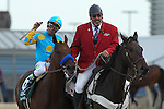 April 11, 2015: American Pharoah with jockey Victor Espinoza aboard celebrating after winning the Arkansas Derby at Oaklawn Park in Hot Springs, AR. Justin Manning/ESW/CSM