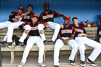 Batavia Muckdogs Iramis Olivencia, Aaron Blanton, Javier Lopez (top bench) and Rodrigo Vigil, Alex Carreras, Ryan Aper (lower bench) in the dugout before a game against the Mahoning Valley Scrappers on August 22, 2014 at Dwyer Stadium in Batavia, New York.  Mahoning Valley defeated Batavia 2-1.  (Mike Janes/Four Seam Images)