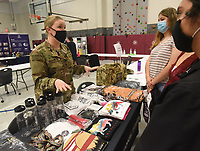 Staff Sgt. Vaughan Cox talks Wednesday April 28 2021 with Rogers New Technology High School students about the benefits of the Army National Guard. Dozens of corporations and organizations took part in the school's internship fair. Go to nwaonline.com/210429Daily/ to see more photos.<br />