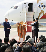 20th March 2020, Miyagi, Tohoku Region, Japan, Olympic gold medalists Tadahiro Nomura and Saori Yoshida light the Olympic cauldron during the Olympic flame arrival ceremony in Miyagi of Japan, on March 20, 2020. The Olympic flame arrived in Japan on March 20.