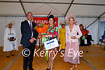 Deirdre Kissane (Listowel) best dressed contemporary style winner at the Ladies Day at the Listowel Races on Friday. L to r: Donal Lynch (McElligott's Garage), Deirdre Kissane (Listowel)  and Celia Holman Lee.