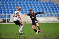 Carli Lloyd evades a defender to set up her goal. The USA captured the 2010 Algarve Cup title by defeating Germany 3-2, at Estadio Algarve on March 3, 2010.