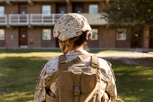 October 22, 2014. Camp LeJeune, North Carolina.<br />  Cpl. Raquel Mathieu takes a break during patrol training for the 3rd Platoon of the Ground Combat Element Integrated Task Force. Marines in 3rd Platoon of the GCEITF are all considered provisional infantrymen as they have not been to the School of Infantry (SOI) previous to volunteering for the GCEITF.<br />  The Ground Combat Element Integrated Task Force is a battalion level unit created in an effort to assess Marines in a series of physical and medical tests to establish baseline standards as the Corps analyze the best way to possibly integrate female Marines into combat arms occupational specialities, such as infantry personnel, for which they were previously not eligible. The unit will be comprised of approx. 650 Marines in total, with about 400 of those being volunteers, both male and female. <br />  Jeremy M. Lange for the Wall Street Journal<br /> COED