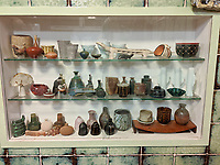 BNPS.co.uk (01202 558833)<br /> Pic: AdamPartridgeAuctioneers/BNPS<br /> <br /> Pictured: The house in Digswell where the serving hatch was repurposed as a display cabinet<br /> <br /> A huge collection of pottery and ceramics found stacked inside the suburban home of an elderly couple has sold for almost £200,000.<br /> <br /> Leonard and Alison Shurz filled every room of their three bed house with ceramic pieces they had gathered from all over the world.<br /> <br /> The Aladdin's Cave of pots, bowls, plates, vases and jugs was found by a stunned auctioneer who had the daunting task of cataloguing it all.