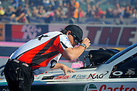 Oct. 30, 2011; Las Vegas, NV, USA: NHRA crew member Dan Hood for funny car driver Mike Neff during the Big O Tires Nationals at The Strip at Las Vegas Motor Speedway. Mandatory Credit: Mark J. Rebilas-