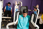 Education High School physical education male students working out on gym equipment