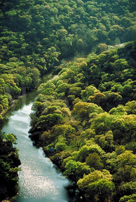Aerial of Sabinal River meandering through Texas Hill Country. Texas, Hillcountry, Sabinal River.