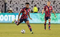 KANSAS CITY, KS - JULY 15: Eryk Williamson #19 of the United States chases down a loose ball during a game between Martinique and USMNT at Children's Mercy Park on July 15, 2021 in Kansas City, Kansas.