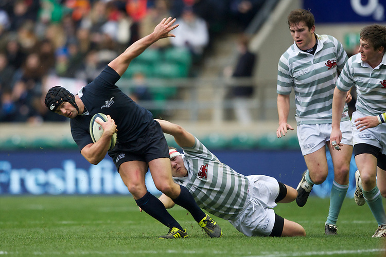 Gavin Turner of Oxford University is tackled by Paul Mallaband of Cambridge University during the 131st Varsity Match between Oxford University and Cambridge University at Twickenham on Thursday 06 December 2012 (Photo by Rob Munro)