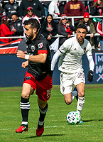 WASHINGTON, DC - FEBRUARY 29: Younes Namli #21 of the Colorado Rapids races up to Felipe Martins #18 of DC United during a game between Colorado Rapids and D.C. United at Audi Field on February 29, 2020 in Washington, DC.