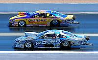 Apr. 5, 2009; Las Vegas, NV, USA: NHRA pro stock driver Rickie Jones (top) races Allen Johnson during eliminations of the Summitracing.com Nationals at The Strip in Las Vegas. Mandatory Credit: Mark J. Rebilas-