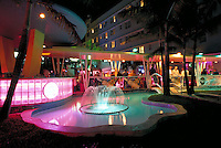 Neon bar at popular hotel on 10 St. + Ocean Dr. Arch - Albert Anis, 1938. Ocean Drive, Miami Beach FL USA.<br />
