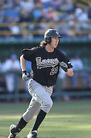 Tim Weis #24 of the Cal Poly Mustangs runs the bases during a game against the UCLA Bruins at Jackie Robinson Stadium on February 22, 2014 in Los Angeles, California. Cal Poly defeated UCLA, 8-0. (Larry Goren/Four Seam Images)