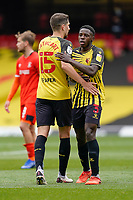 Craig Cathcart (15) of Watford and Jeremy Ngakia (3) of Watford after the Sky Bet Championship match between Watford and Luton Town at Vicarage Road, Watford, England on 26 September 2020. Photo by David Horn.