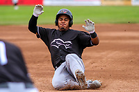 Quad Cities River Bandits catcher Ruben Castro (10) slides into third base during a Midwest League game against the Beloit Snappers on May 20, 2018 at Pohlman Field in Beloit, Wisconsin. Beloit defeated Quad Cities 3-2. (Brad Krause/Four Seam Images)