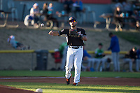Salem-Keizer Volcanoes third baseman David Villar (5) throws to first base during a Northwest League game against the Eugene Emeralds at Volcanoes Stadium on August 31, 2018 in Keizer, Oregon. The Eugene Emeralds defeated the Salem-Keizer Volcanoes by a score of 7-3. (Zachary Lucy/Four Seam Images)