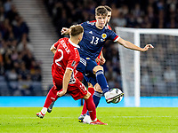 4th September 2021; Hampden Park, Glasgow, Scotland: FIFA World Cup 2022 qualification football, Scotland versus Moldova: Jack Hendry of Scotland and Oleg Reabciuk of Moldova compete for possession of the ball