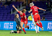 ORLANDO, FL - FEBRUARY 21: Sarah Stratigakis #10 of Canada celebrates her goal with Sophie Schmidt #13 during a game between Canada and Argentina at Exploria Stadium on February 21, 2021 in Orlando, Florida.