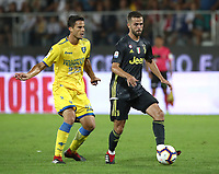 Calcio, Serie A: Frosinone-Juventus, Benito Stirpe stadium, Frosinone, September 23, 2018. <br /> Juventus' Miralem Pjanic (r) in action with Frosinone's Lorenzo Crisetig (l) during the Italian Serie A football match between Frosinone and Juventus at Frosinone stadium on September 23, 2018.<br /> UPDATE IMAGES PRESS/Isabella Bonotto