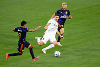 CARSON, CA - JUNE 19: Sacha Kljestan #16 of the Los Angeles Galaxy tackling Raúl Ruidíaz #9 of Seattle Sounders FC during a game between Seattle Sounders FC and Los Angeles Galaxy at Dignity Health Sports Park on June 19, 2021 in Carson, California.