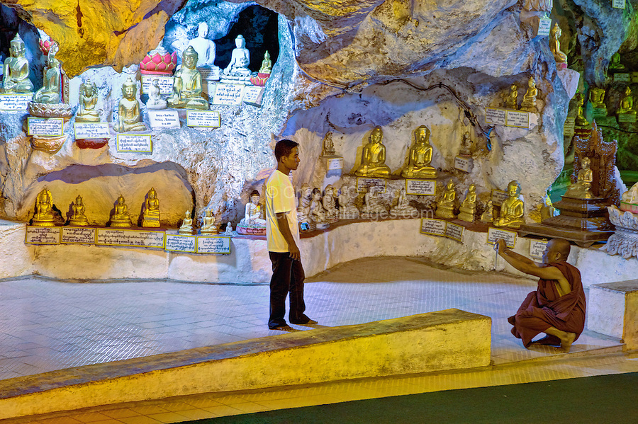 Buddhist Monk Photographing a Friend in the Shwe Oo Min Cave, Pindaya, Shan State, Myanmar, Burma.
