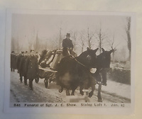 BNPS.co.uk (01202 558833)<br /> Pic: TheCotswoldAuctionCompany/BNPS<br /> <br /> Pictured: The funeral of Sgt John Cecil Shaw at Stalag Luft in January 1942.<br /> <br /> A remarkable cache of rarely seen photos capturing life inside the Great Escape PoW camp has been discovered in a barn.<br /> <br /> The images, taken at Stalag Luft III in 1942 and 1943, show Allied prisoners dressed as women doing amateur-dramatics and an action-packed sports day.<br /> <br /> They donned bikinis and other extravagant outfits as they entertained their camp mates with performances of 'Aladdin' and 'Girls, Girls, Girls'.<br /> <br /> Hundreds of PoWs perched on roofs to watch the sports day which featured sprint races, the long jump, the high jump and a discus competition.