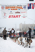 Joar Leifseth Ulsom and team leave the ceremonial start line at 4th Avenue and D street in downtown Anchorage during the 2013 Iditarod race. Photo by Jim R. Kohl/IditarodPhotos.com