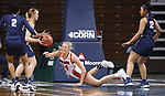 SIOUX FALLS, SD - MARCH 6: Hannah Sjerven #34 of the South Dakota Coyotes tries to pass the ball while falling during their game against Oral Roberts Golden Eagles during the Summit League Basketball Tournament at the Sanford Pentagon in Sioux Falls, SD. (Photo by Richard Carlson/Inertia)