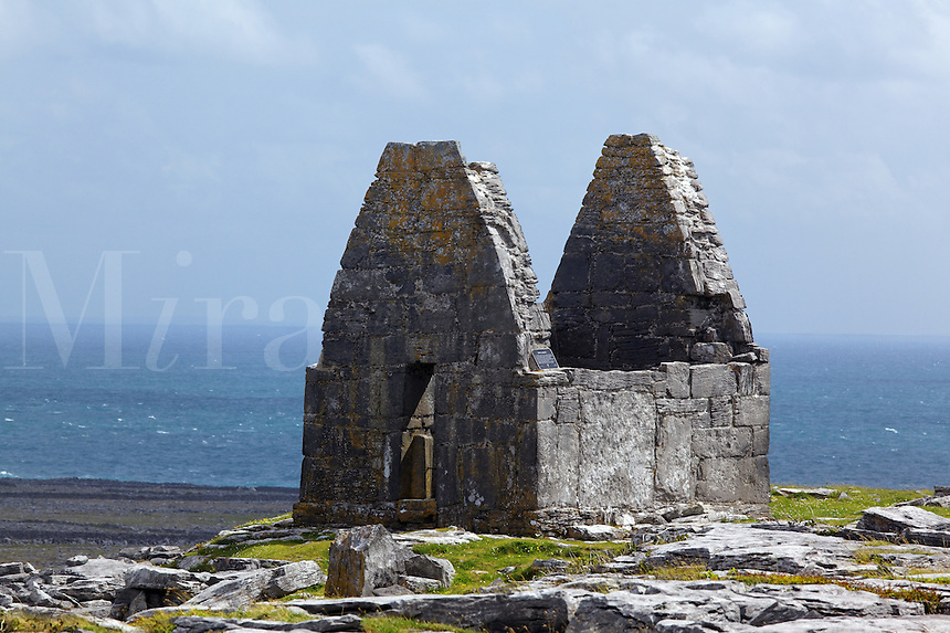 The remains of St. Benen's Church (Teampull Bheanáin) overlook the Atlantic Ocean on the island of Inishmore, Aran Islands, County Galway, Republic of Ireland