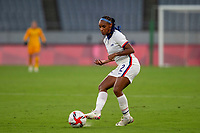 TOKYO, JAPAN - JULY 21: Crystal Dunn #2 of the United States passes the ball during a game between Sweden and USWNT at Tokyo Stadium on July 21, 2021 in Tokyo, Japan.