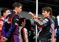 Feb 22, 2009; Fontana, CA, USA; NASCAR Sprint Cup Series driver Jeff Gordon (right) talks with Denny Hamlin prior to the Auto Club 500 at Auto Club Speedway. Mandatory Credit: Mark J. Rebilas-