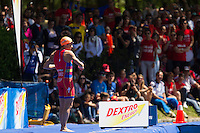 02 JUN 2013 - MADRID, ESP - Javier Gomez (ESP) of Spain stretches in front of Spanish fans before the start of the men's ITU 2013 World Triathlon Series round at Casa de Campo in Madrid, Spain <br /> (PHOTO (C) 2013 NIGEL FARROW)