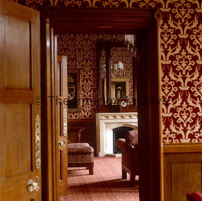 One of the rooms in the Lord Chancellor's apartments is decorated with a flocked, damask wallpaper and a patterned carpet