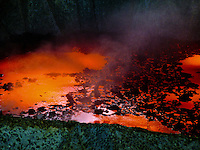 Orange-lit water doubles for lava at Bishop Museum's volcano.