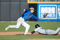 Ethan Murray (1) of the Duke Blue Devils fields a throw as Scott McKeon (10) of the Coastal Carolina Chanticleers attempts to steal second base at Segra Stadium on November 2, 2019 in Fayetteville, North Carolina. (Brian Westerholt/Four Seam Images)