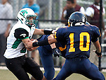 Waterbury, CT-07 September 2012-090712CM11-  Wilby's Jacob Thomas looks for the end zone as Kennedy's Rich Vo moves in to try and make the tackle during the second quarter at the City Jamboree Friday night at Municipal Stadium in Waterbury.  Wilby would later defeat Sacred Heart for the Jamboree Championship.      Christopher Massa Republican-American