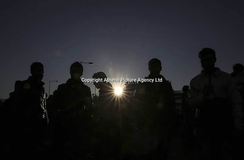 Pictured: Silhouettes of migrants having just arrived at the port Monday 22 February 2016<br /> Re: Thousands of migrants, most from Syria, have landed to the port of Pireaus, after crossing the border from Turkey to various islands like Lesvos and Kos in Greece.