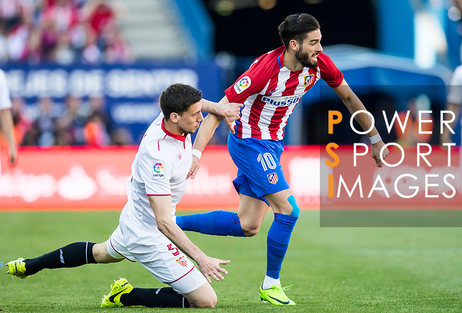 Yannick Ferreira Carrasco (r) of Atletico de Madrid battles for the ball with Clement Lenglet of Sevilla FC during their La Liga match between Atletico de Madrid and Sevilla FC at the Estadio Vicente Calderon on 19 March 2017 in Madrid, Spain. Photo by Diego Gonzalez Souto / Power Sport Images