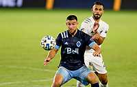 CARSON, CA - OCTOBER 18: Lucas Cavallini #9 of the Vancouver Whitecaps and Giancarlo Gonzalez #21 of the Los Angeles Galaxy battle for a ball during a game between Vancouver Whitecaps and Los Angeles Galaxy at Dignity Heath Sports Park on October 18, 2020 in Carson, California.