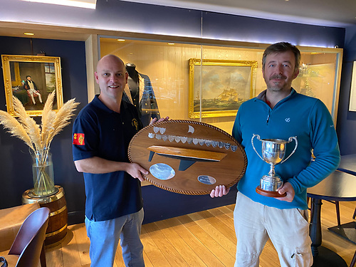 Royal Cork's Darragh Connolly (left) presents the 'Moonduster' award to Cracker skipper Denis Byrne