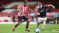 Bryan Mbeumo of Brentford takes on Charlton's Alfie Doughty during Brentford vs Charlton Athletic, Sky Bet EFL Championship Football at Griffin Park on 7th July 2020