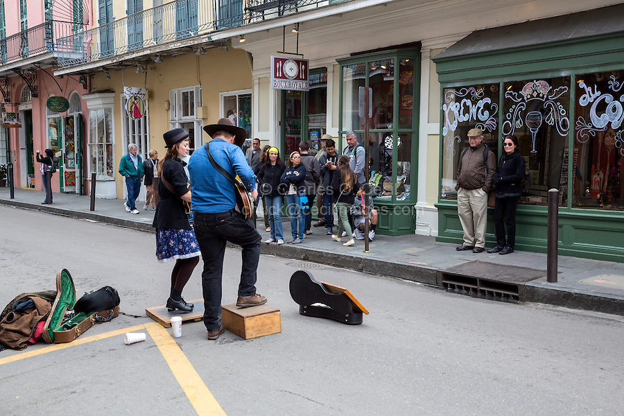 French Quarter, New Orleans, Louisiana.  Tourists Watching Street Performers on Royal Street.