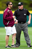 Third Base Umpire Travis Olson talks with Missouri State Athletic Training student Ben Hicks during a game between the Bradley Braves and the Missouri State Bears on May 13, 2011 at Hammons Field in Springfield, Missouri.  Photo By David Welker/Four Seam Images..