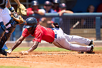 FCL Twins outfielder Luis Baez (11) slides home safely during a game against the FCL Rays on July 20, 2021 at Charlotte Sports Park in Port Charlotte, Florida.  (Mike Janes/Four Seam Images)