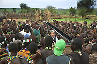 """Ethiopia. Southern Nations, Nationalities, and Peoples' Region. Omo Valley. Turmi. Hamar tribe (also spelled Hamer). Pastoralist group. Marc Vella is a french musician and a nomadic pianist. Over the last 25 years he has travelled with his Grand Piano in around forty countries to celebrate humanity. Creator of """"La Caravane amoureuse"""" (The Caravan of Love) he takes people with him to say """"I love you"""" to others and """"lovingly conquered"""" their hearts and souls. The Omo Valley, situated in Africa's Great Rift Valley, is home to an estimated 200,000 indigenous peoples who have lived there for millennia. Amongst them are 60'000 to 70'000 Hamar, an Omotic community inhabiting southwestern Ethiopia. Southern Nations, Nationalities, and Peoples' Region (often abbreviated as SNNPR) is one of the nine ethnic divisions of Ethiopia. 7.11.15 © 2015 Didier Ruef"""