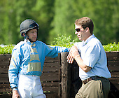 Arch Kingsley, left, donned jockey's silks once again and chats with flat trainer Will Phipps in the paddock before the 5th race at Mineral Springs.