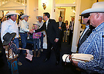 Gov. Brian Sandoval greets Dan Filipini and dozens of ranchers at the Capitol in Carson City, Nev., on Friday, May 30, 2014. About 40 people rode horses into downtown Carson City today to deliver a petition to the governor calling attention to the ongoing fight between ranchers and the BLM over grazing on public lands. <br /> Photo by Cathleen Allison