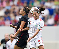 Carli Lloyd (10) of the USWNT  goes up for a header with Lupita Worbis (8) of Mexico during the game at Red Bull Arena in Harrison, NJ.  The USWNT defeated Mexico, 1-0.
